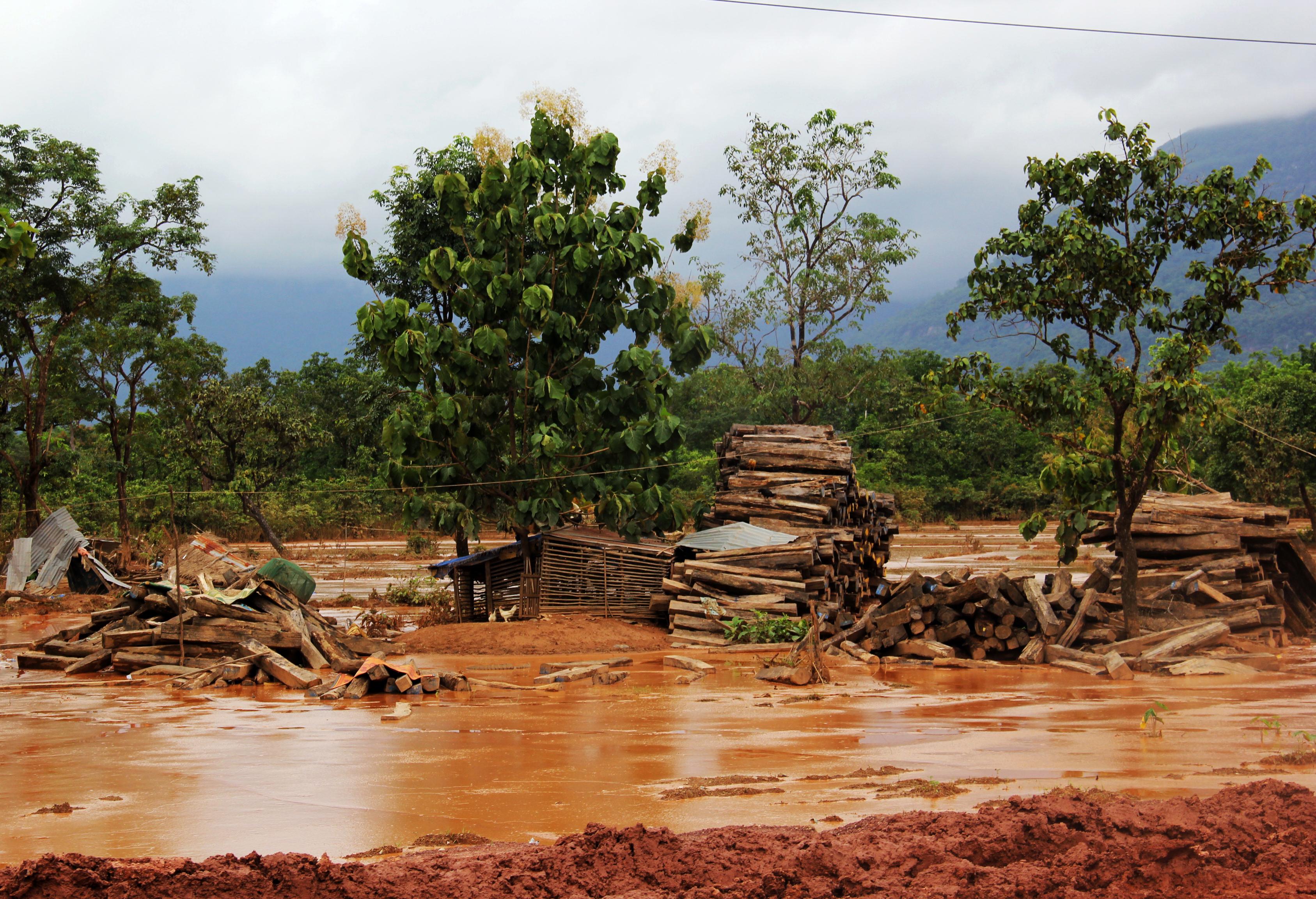 A flood-ravaged road in Khammouane.