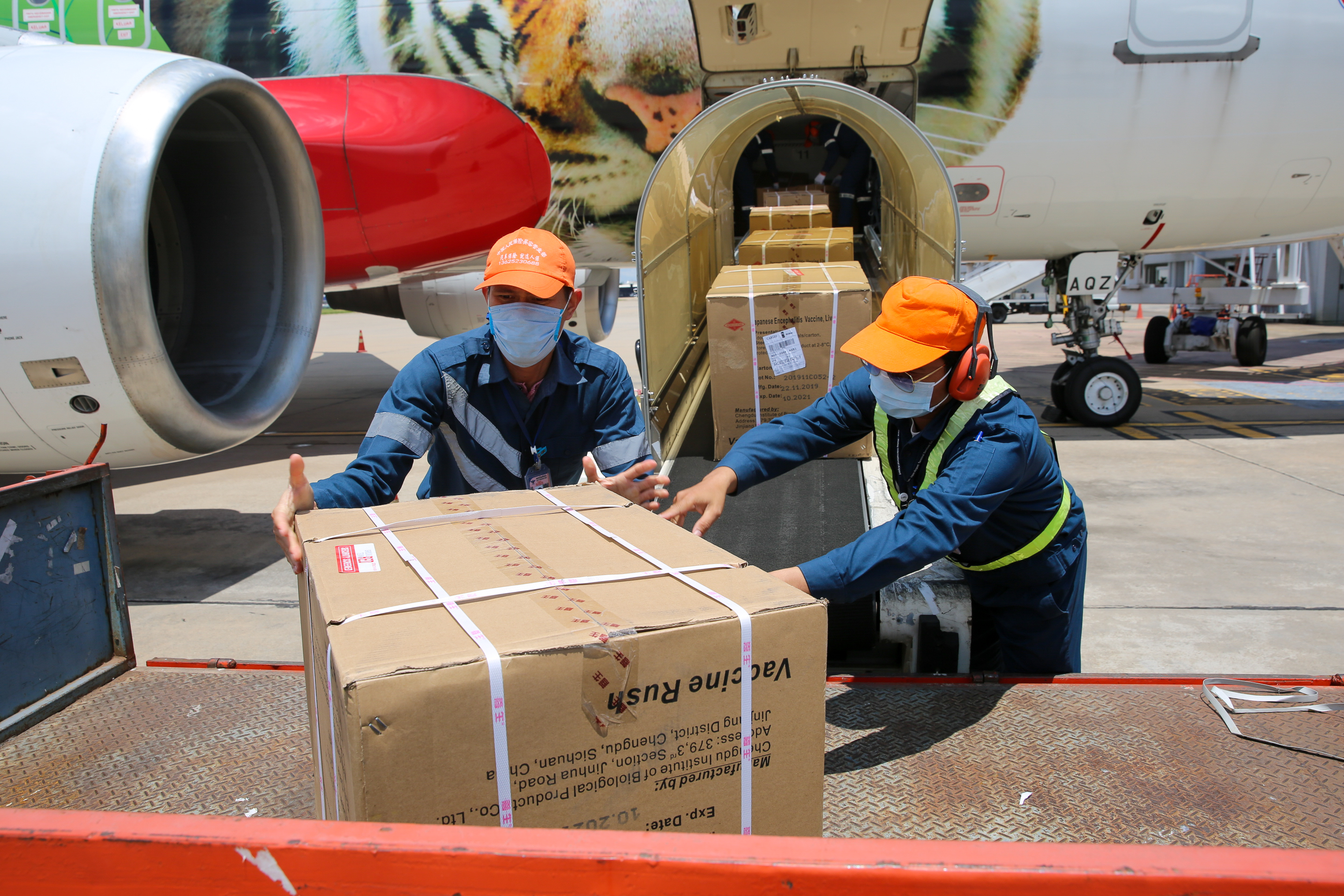Vaccines procured by UNICEF arrive at Wattay Airport, Vientiane.