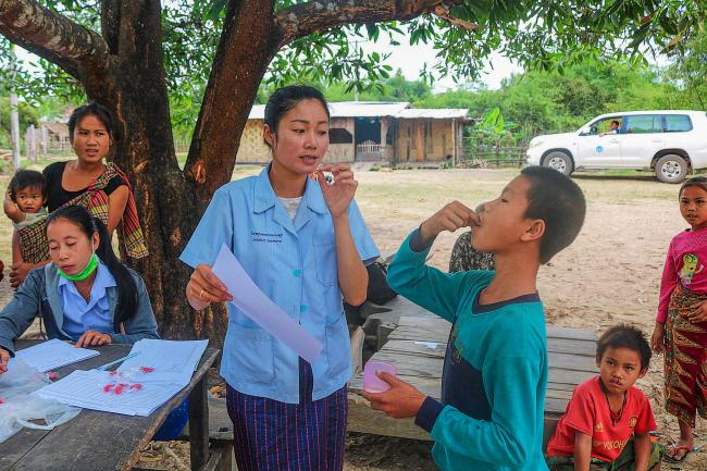 Nurses carry out vaccination in rural Lao PDR.